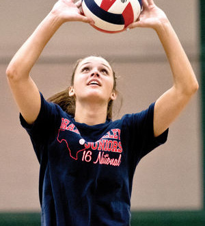 Allison Vaughn of Rudder HS sets a teammate up with a set