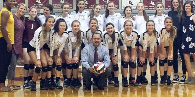 Dripping Springs head coach Michael Kane enjoys victory #600 (Oct. 7, 2016) with his Lady Tigers.